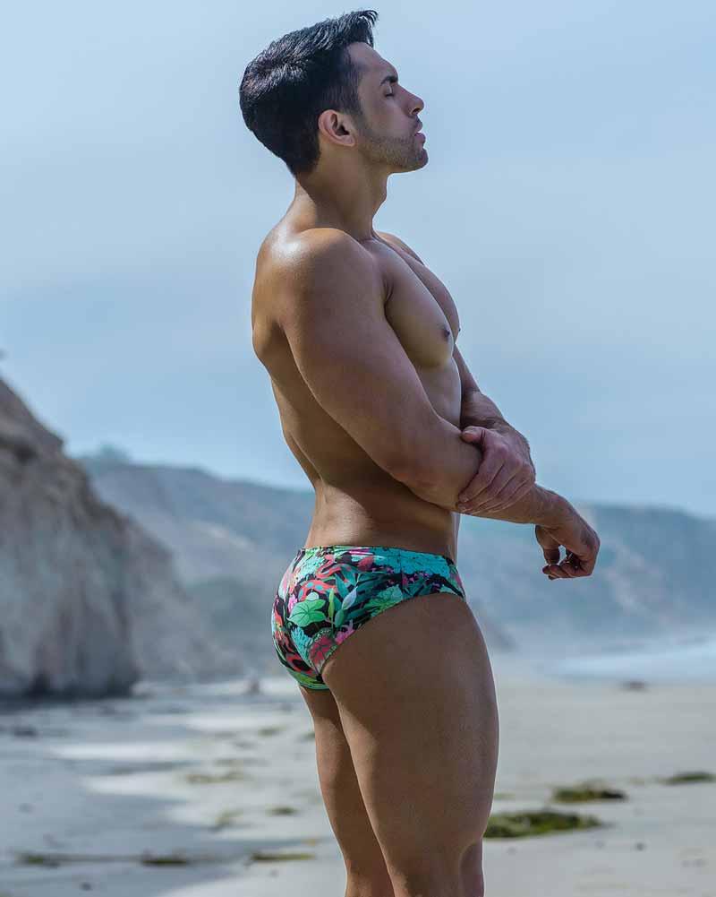 Chris gogo dancer wears reversible green swim briefs